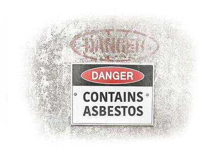 asbestos danger sign on the wall